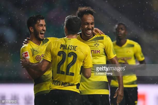 PierreEmerick Aubameyang of Borussia Dortmund celebrates a goal with Christian Pulisic and Nuri Sahin during the 2017 International Champions Cup...