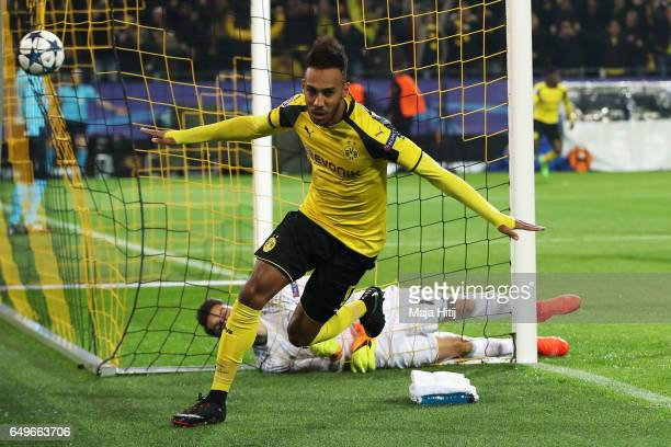 PierreEmerick Aubameyang of Borussia Dortmund celebrates after he headers the ball to score the first goal of the ganme during the UEFA Champions...