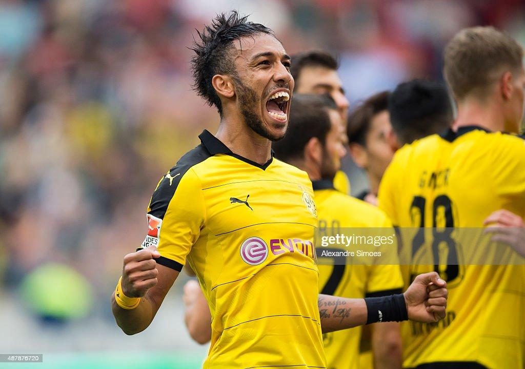 PierreEmerick Aubameyang of Borussia Dortmund celebrates after scoring his team's 4th goal during the Bundesliga match between Hanover 96 v Borussia...