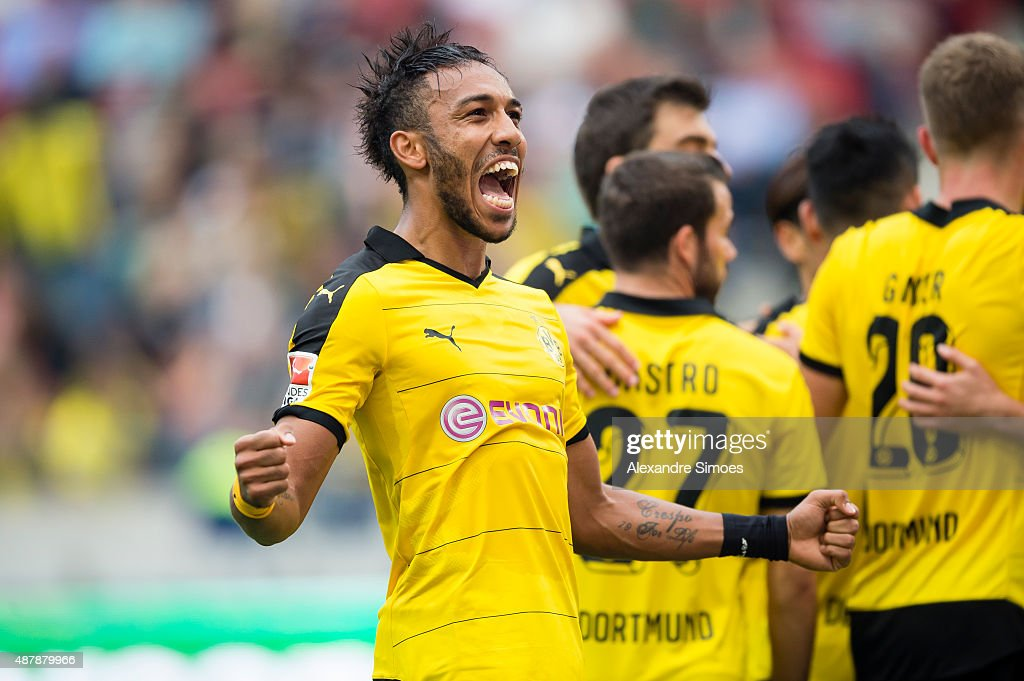 <a gi-track='captionPersonalityLinkClicked' href=/galleries/search?phrase=Pierre-Emerick+Aubameyang&family=editorial&specificpeople=6344916 ng-click='$event.stopPropagation()'>Pierre-Emerick Aubameyang</a> of Borussia Dortmund celebrates after scoring his team's 4th goal during the Bundesliga match between Hanover 96 v Borussia Dortmund at HDI-Arena on September 12, 2015 in Hanover, Germany.