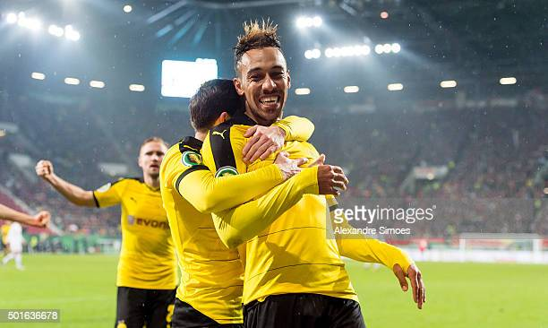 PierreEmerick Aubameyang of Borussia Dortmund celebrates after scoring the opening goal with team mate Gonzalo Castro during the DFB Cup match...