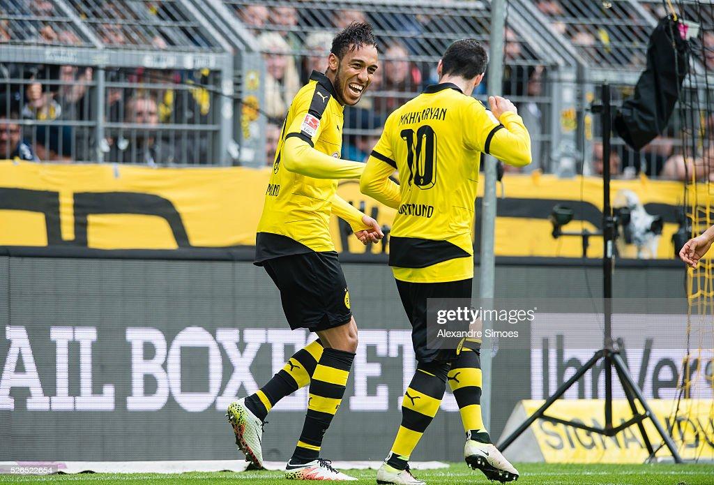 Pierre-Emerick Aubameyang of Borussia Dortmund celebrates after scoring the goal to the 4:0 together with Henrikh Mkhitaryan during the Bundesliga match between Borussia Dortmund and VfL Wolfsburg at Signal Iduna Park on April 30, 2016 in Dortmund, Germany.