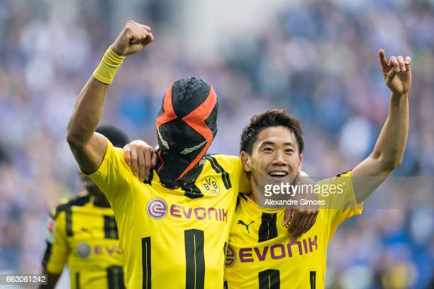 PierreEmerick Aubameyang of Borussia Dortmund celebrates after scoring the opening goal together with Shinji Kagawa during the to the Bundesliga...
