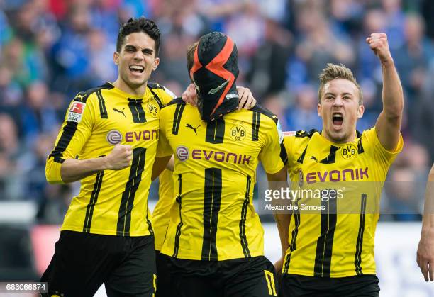 PierreEmerick Aubameyang of Borussia Dortmund celebrates after scoring the opening goal together with his team mates during the to the Bundesliga...
