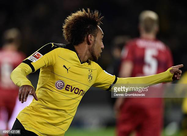 PierreEmerick Aubameyang of Borussia Dortmund celebrates as he scores the fourth goal during the Bundesliga match between Borussia Dortmund and VfB...