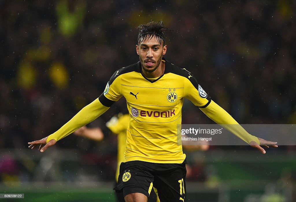 PierreEmerick Aubameyang of Borussia Dortmund celebrates as he scores their second goal during the DFB Cup Quarter Final match between VfB Stuttgart...