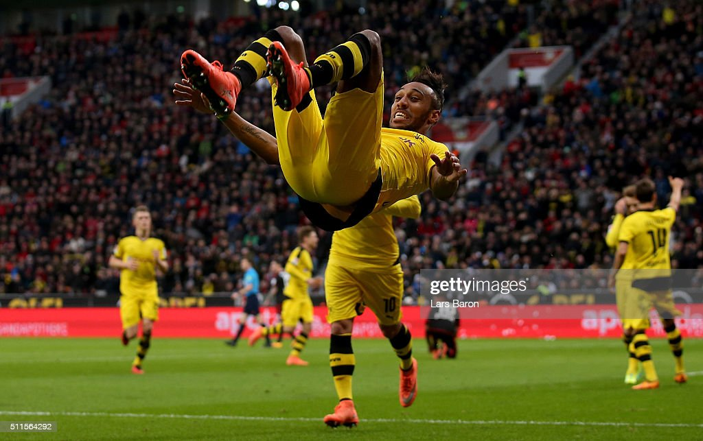 Pierre-Emerick Aubameyang of Borussia Dortmund celebrates as he scores their first goal during the Bundesliga match between Bayer Leverkusen and Borussia Dortmund at BayArena on February 21, 2016 in Leverkusen, Germany.