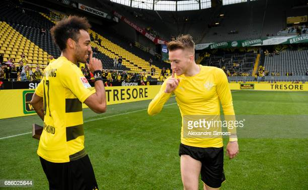 PierreEmerick Aubameyang of Borussia Dortmund celebrates getting the trophy for being the top scorer of this season together with Marco Reus after...
