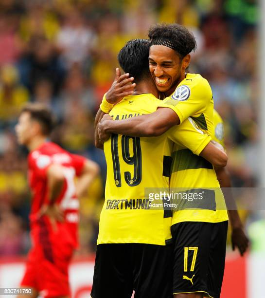 PierreEmerick Aubameyang of Borussia Dortmund celebrates his third goal during the DFB Cup match between 1 FC RielasingenArlen and Borussia Dortmund...