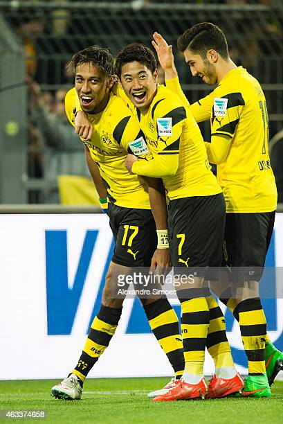 PierreEmerick Aubameyang of Borussia Dortmund celebrates scoring his goal to the 32 together with team mates Shinji Kagawa and Nuri Sahin during the...