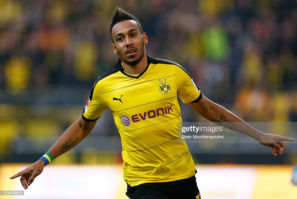 PierreEmerick Aubameyang of Borussia Dortmund celebrates scoring his team's first goal during the Bundesliga match between Borussia Dortmund and...