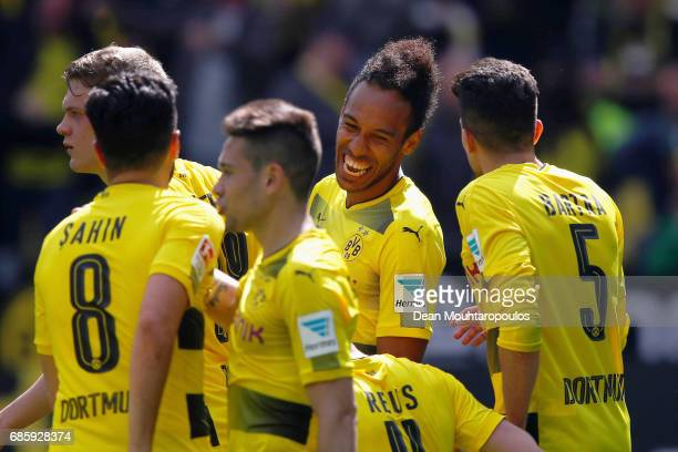 PierreEmerick Aubameyang of Borussia Dortmund celebrates scoring his teams second goal of the game with team mates after he shoots and scores during...