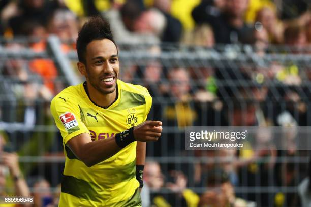 PierreEmerick Aubameyang of Borussia Dortmund celebrates scoring his teams fourth goal of the game during the Bundesliga match between Borussia...