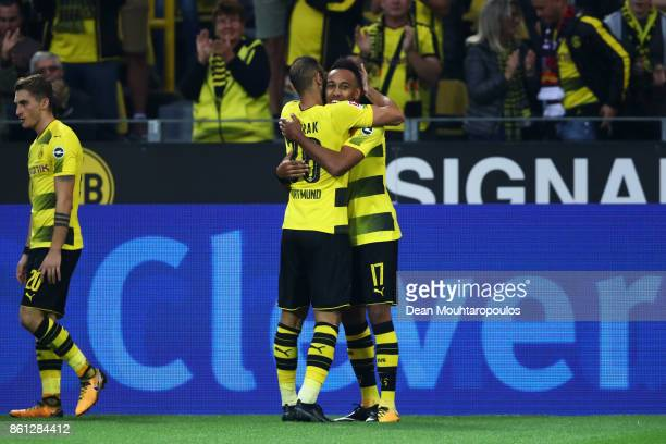 PierreEmerick Aubameyang of Borussia Dortmund celebrates scoring his teams first goal of the game with team mate Omer Toprak during the Bundesliga...
