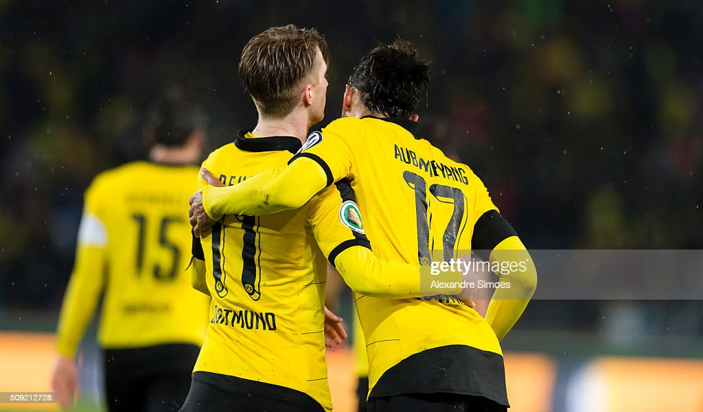 Pierre-Emerick Aubameyang of Borussia Dortmund celebrates scoring the goal to the 1:2 together with Marco Reus during the DFB Cup match between VfB Stuttgart and Borussia Dortmund at Mercedes-Benz Arena on February 09, 2016 in Stuttgart, Germany.