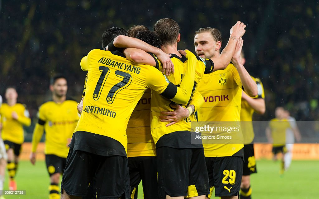 Pierre-Emerick Aubameyang of Borussia Dortmund celebrates scoring the goal to the 1:2 together with his team mates during the DFB Cup match between VfB Stuttgart and Borussia Dortmund at Mercedes-Benz Arena on February 09, 2016 in Stuttgart, Germany.