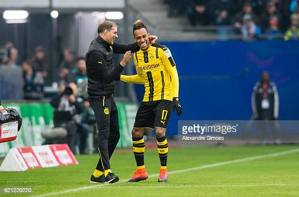 PierreEmerick Aubameyang of Borussia Dortmund celebrates scoring the opening goal together with his head coach Thomas Tuchel during the Bundesliga...