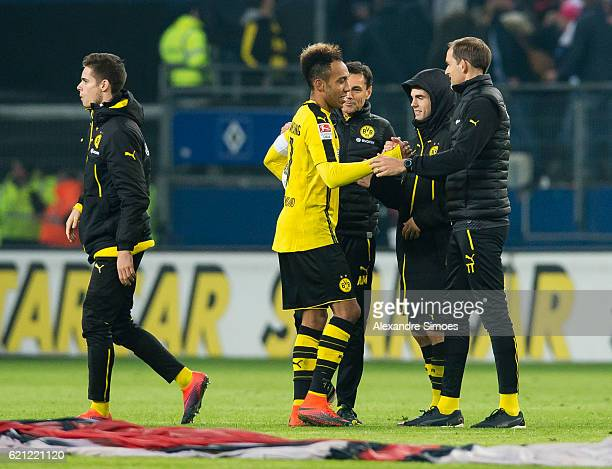 PierreEmerick Aubameyang of Borussia Dortmund celebrates the win together with his head coach Thomas Tuchel after the final whistle during the...