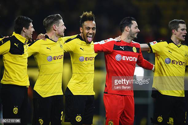 PierreEmerick Aubameyang of Borussia Dortmund celebrates victory with team mates after the Bundesliga match between Borussia Dortmund and Eintracht...