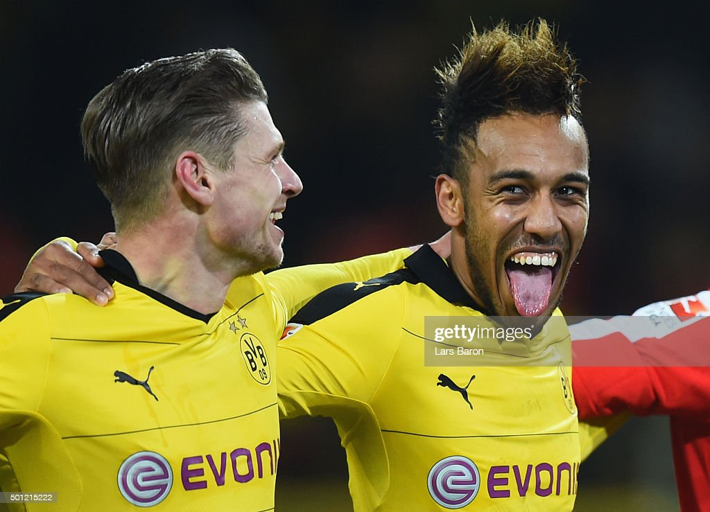 PierreEmerick Aubameyang of Borussia Dortmund celebrates victory with team mate Lukasz Piszczek after the Bundesliga match between Borussia Dortmund...