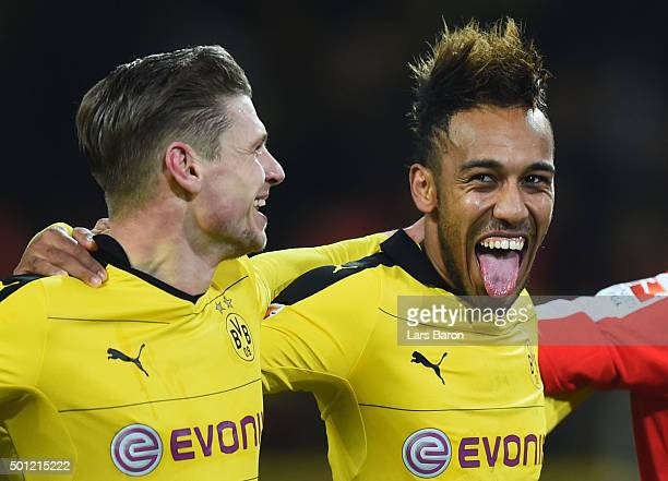 PierreEmerick Aubameyang of Borussia Dortmund celebrates victory with team mate Lukasz Piszczek after the Bundesliga match between Borussia Dortmund...
