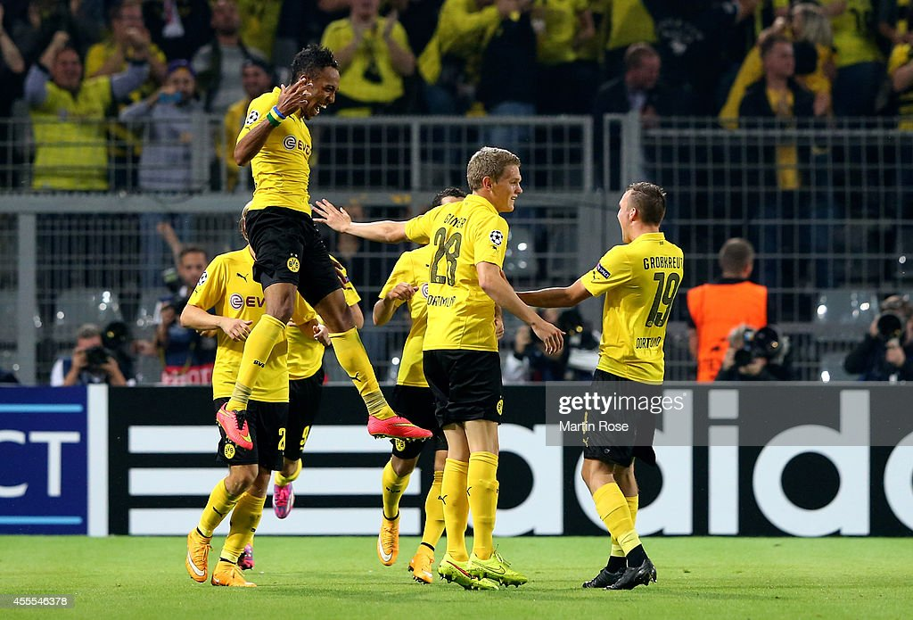 Pierre-Emerick Aubameyang (L) of Borussia Dortmund celebrates with teammates after scoring his team's second goal during the UEFA Champions League Group D match between Borussia Dortmund and Arsenal at Signal Iduna Park on September 16, 2014 in Dortmund, Germany.