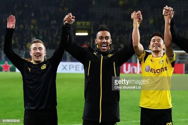 PierreEmerick Aubameyang of Borussia Dortmund celebrates with teammates Felix Passlack and Shinji Kagawa at the end of the UEFA Champions League...