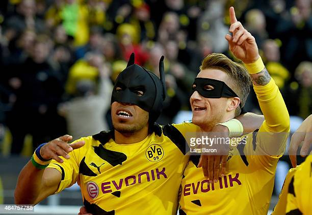 PierreEmerick Aubameyang of Borussia Dortmund celebrates with Marco Reus of Borussia Dortmund after scoring his teams first goal during hte...