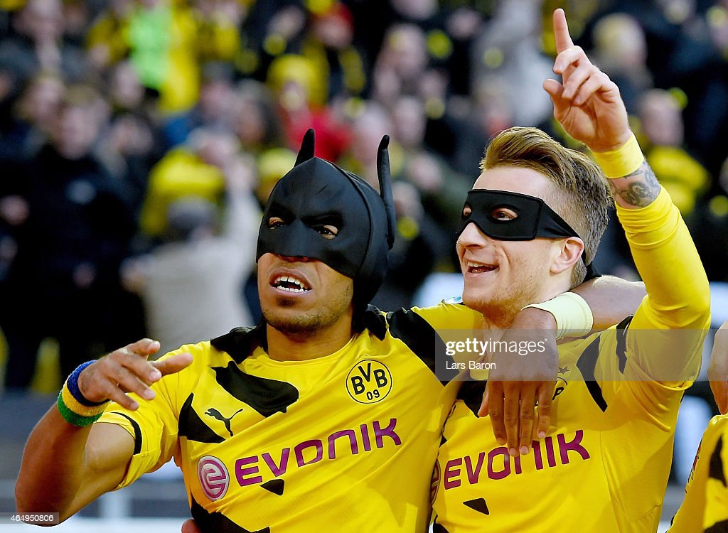 Pierre-Emerick Aubameyang of Borussia Dortmund celebrates with Marco Reus of Borussia Dortmund after scoring his teams first goal during hte Bundesliga match between Borussia Dortmund and FC Schalke 04 at Signal Iduna Park on February 28, 2015 in Dortmund, Germany.