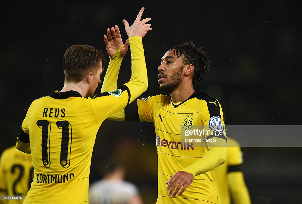 <a gi-track='captionPersonalityLinkClicked' href=/galleries/search?phrase=Pierre-Emerick+Aubameyang&family=editorial&specificpeople=6344916 ng-click='$event.stopPropagation()'>Pierre-Emerick Aubameyang</a> of Borussia Dortmund celebrates with <a gi-track='captionPersonalityLinkClicked' href=/galleries/search?phrase=Marco+Reus&family=editorial&specificpeople=5445884 ng-click='$event.stopPropagation()'>Marco Reus</a> as he scores their second goal during the DFB Cup Quarter Final match between VfB Stuttgart and Borussia Dortmund at Mercedes-Benz Arena on February 9, 2016 in Stuttgart, Germany.