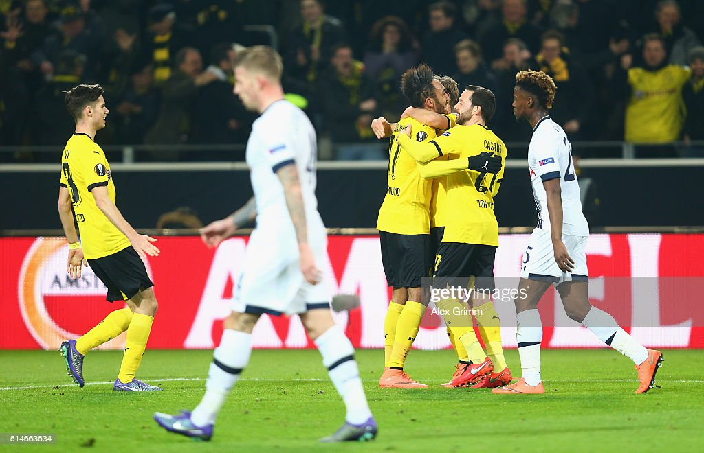 Pierre-Emerick Aubameyang of Borussia Dortmund (4R) celebrates with team mates as he scores their first goal during the UEFA Europa League Round of 16 first leg match between Borussia Dortmund and Tottenham Hotspur at Signal Iduna Park on March 10, 2016 in Dortmund, Germany.