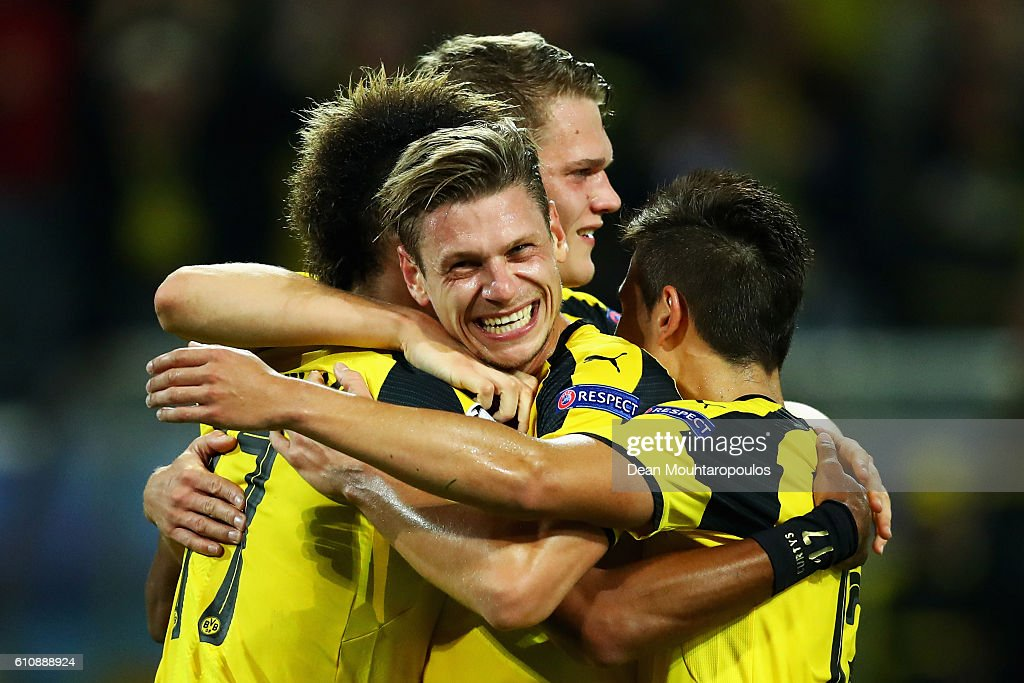 Pierre-Emerick Aubameyang (L) of Borussia Dortmund #17 celebrates with team mates including Lukasz Piszczek (C) as he scores their first goal during the UEFA Champions League Group F match between Borussia Dortmund and Real Madrid CF at Signal Iduna Park on September 27, 2016 in Dortmund, North Rhine-Westphalia during the UEFA Champions League match between XXX and XXX at Signal Iduna Park on September 27, 2016 in Dortmund, North Rhine-Westphalia.