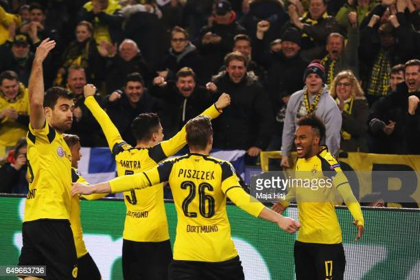 PierreEmerick Aubameyang of Borussia Dortmund celebrates with team mates after he headers the ball to score the first goal of the ganme during the...