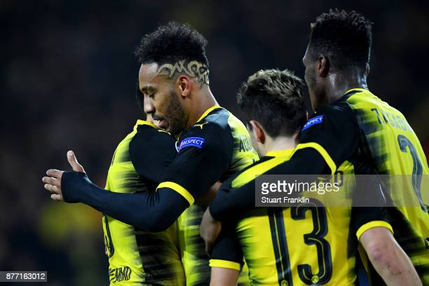 PierreEmerick Aubameyang of Borussia Dortmund celebrates with team mates after scoring his sides first goal during the UEFA Champions League group H...