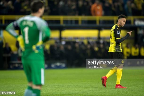 PierreEmerick Aubameyang of Borussia Dortmund celebrates with team mates after scoring his team's first goal against goalkeeper Hugo Lloris of...