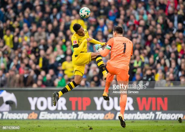 PierreEmerick Aubameyang of Borussia Dortmund challenges goal keeper Philipp Tschauner of Hannover 96 during the Bundesliga match between Hannover 96...