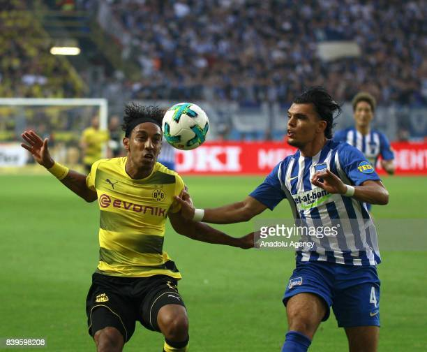 PierreEmerick Aubameyang of Borussia Dortmund challenges with Karim Rekik of Hertha BSC Berlin during the Bundesliga soccer match between Borussia...