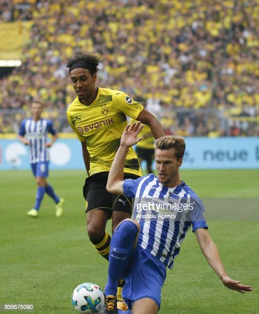 PierreEmerick Aubameyang of Borussia Dortmund challenges with Sebastian Langkamp of Hertha BSC Berlin during the Bundesliga soccer match between...