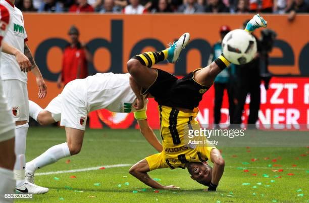 PierreEmerick Aubameyang of Borussia Dortmund collides with Paul Verhaegh of Augsburg during the Bundesliga match between FC Augsburg and Borussia...