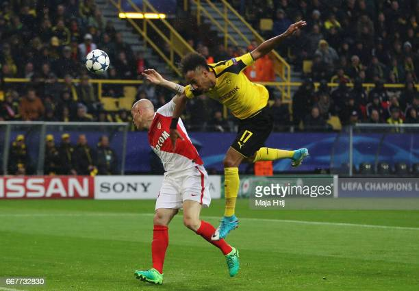 PierreEmerick Aubameyang of Borussia Dortmund fails to connect with a header with Andrea Raggi of AS Monaco during the UEFA Champions League Quarter...