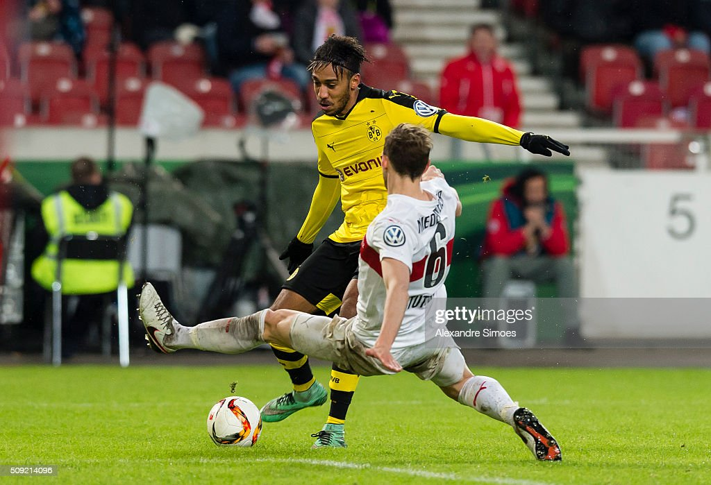 Pierre-Emerick Aubameyang of Borussia Dortmund gets challenged by Georg Niedermeier of Stuttgart during the DFB Cup match between VfB Stuttgart and Borussia Dortmund at Mercedes-Benz Arena on February 09, 2016 in Stuttgart, Germany.