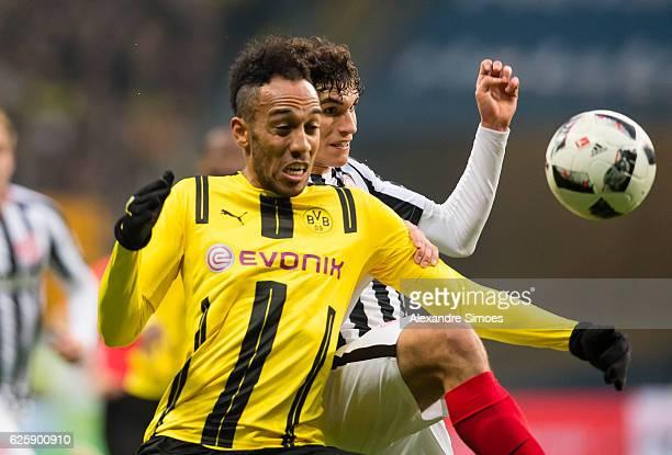 PierreEmerick Aubameyang of Borussia Dortmund gets challenged by Jesus Vallejo of Eintracht Frankfurt during the Bundesliga match between Eintracht...