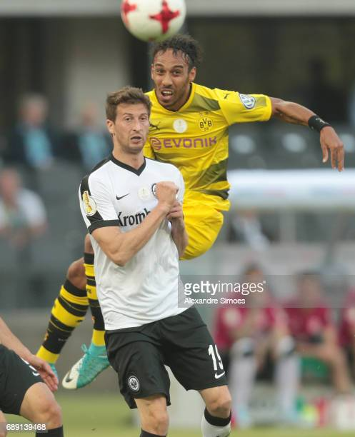 PierreEmerick Aubameyang of Borussia Dortmund gets challenged by David Abraham of Eintracht Frankfurt during the DFB Cup Final match between...