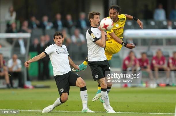 PierreEmerick Aubameyang of Borussia Dortmund gets challenged by Jesus Vallejo and David Abraham of Eintracht Frankfurt during the DFB Cup Final...