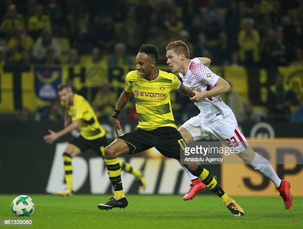 PierreEmerick Aubameyang of Borussia Dortmund in action against Marcel Halstenberg of Rasenballsport Leipzig during the Bundesliga soccer match...