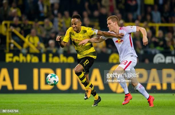 PierreEmerick Aubameyang of Borussia Dortmund in the battel for the ball against Marcel Halstenberg of RB Leipzig during the Bundesliga match between...