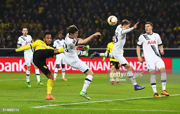 PierreEmerick Aubameyang of Borussia Dortmund is blocked by Ben Davies and Tom Carroll of Tottenham Hotspur during the UEFA Europa League Round of 16...