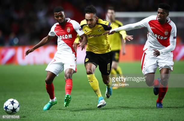 PierreEmerick Aubameyang of Borussia Dortmund is challenegd by Nabil Dirar of Monaco and Jemerson of Monaco during the UEFA Champions League Quarter...