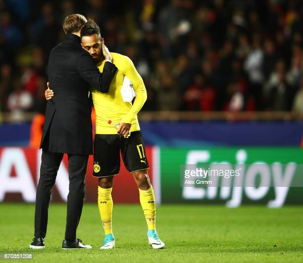 PierreEmerick Aubameyang of Borussia Dortmund is comforted by Thomas Tuchel head coach of Borussia Dortmund after losing the UEFA Champions League...