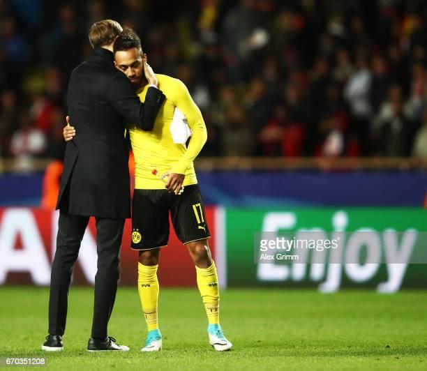 PierreEmerick Aubameyang of Borussia Dortmund is comforted by Thomas Tuchel head coach of Borussia Dortmund after losing the UEFA Champions League...